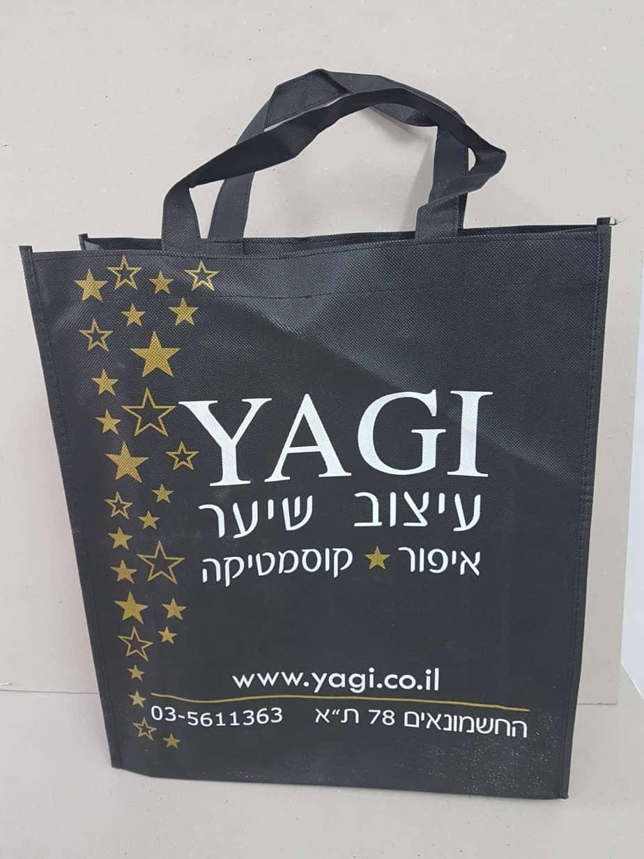 תיק אלבד שחור ממותג של yagi